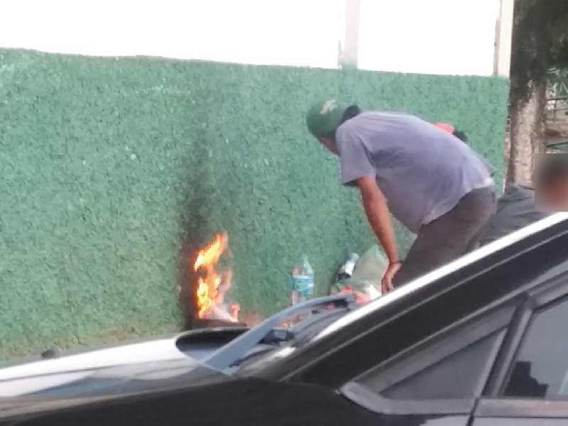 Homem fazia fogareiro para esquentar comida na parede do anexo à prefeitura